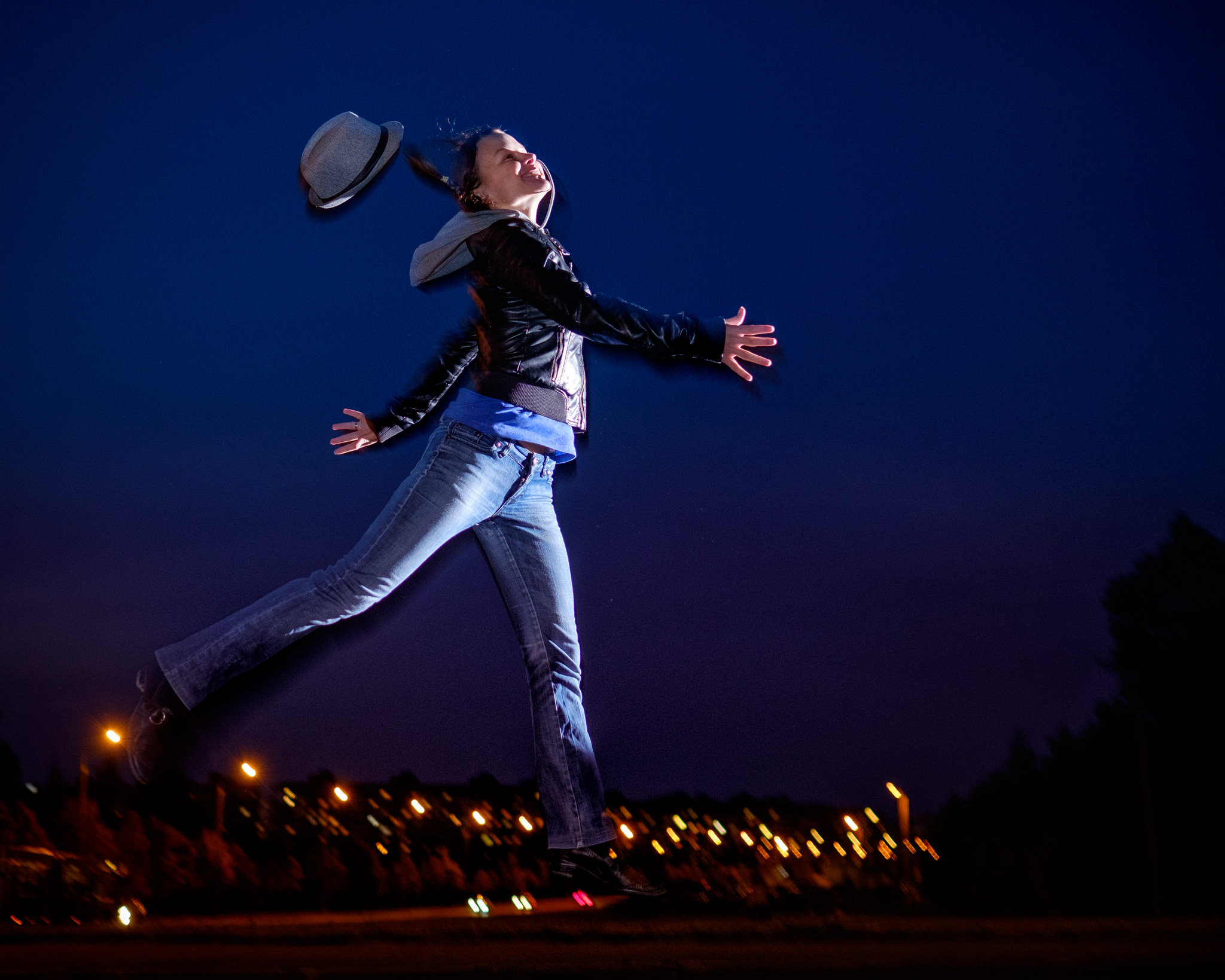 Nighttime portrait with flying hat